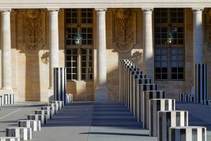 PARIS, FRANCE, March 12, 2015 : The Palais Royal originally called the Palais-Cardinal is a palace whose entrance court faces the Louvre Palace. The larger inner courtyard contains Buren's art piece, known as Les Colonnes de Buren.